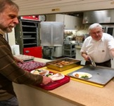 Mark Reaman of Project Rise helps serve the meal alongside Richard Seegard of FUMC